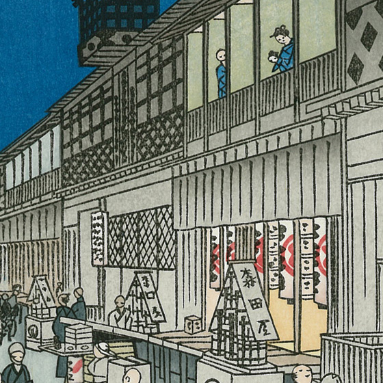 手前の看板には森田座の文字。中村座、市村座とともに「江戸三座」と呼ばれ、この三座の芝居小屋が猿若町に集められました。